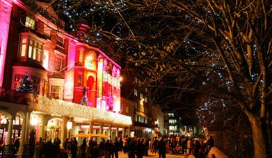 exterior of Theatre Royal at night with Christmas lights