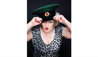 Abi Roberts pouting with a Russian military hat on