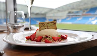 Dessert with stadium in the background