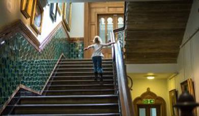 girl on stairs at Brighton Museum