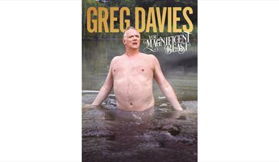 Greg Davies coming out of a river or lake bare chested