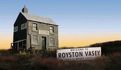 house with sign saying 'Welcome to Royston Vasey'