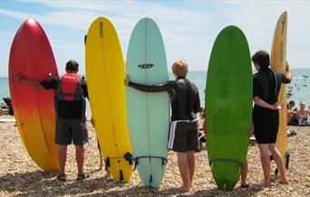 Paddle Round the Pier - Surfers holding Surfboards