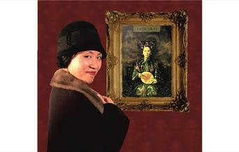 Lady with fur coast looking at painting of a Japanese Empress