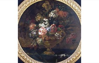Oil Painting | Assorted flowers, predominantly pink, white and blue, in a golden vase with curled handle at right, standing on a table I Jean Baptiste