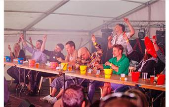 people taking part in a chilli eating competition