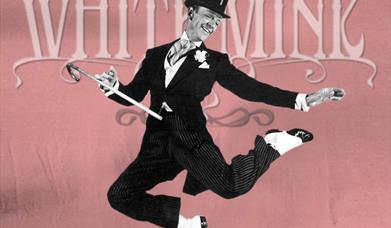 Man in Top Hat and Tails leaping in the air with a  walking stick
