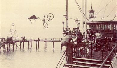 Man jumping off bicycle in mid air into the sea!